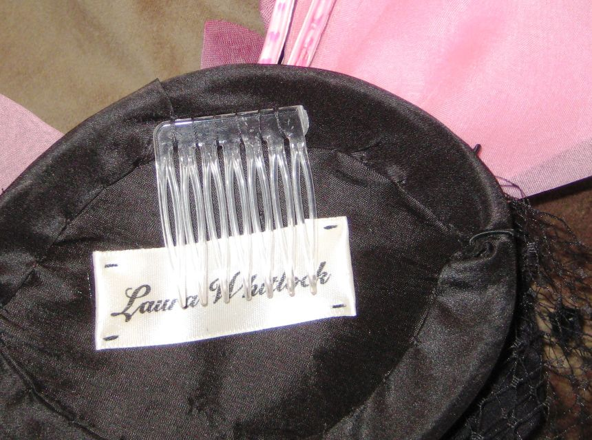 The most basic attachment for a hat or a small headpiece/fascinator is a comb.