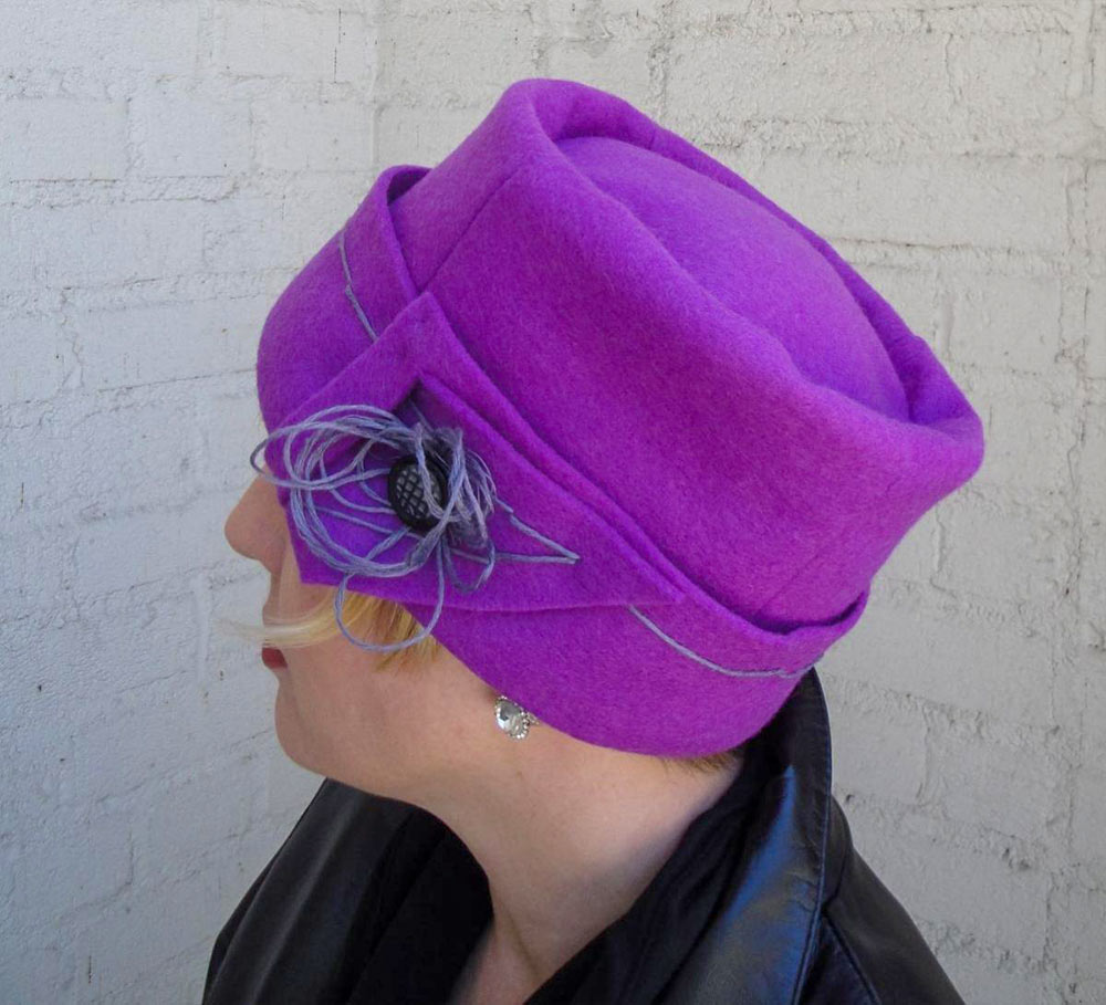 Lee St. Mare wearing an Orchid Cloche, side view
