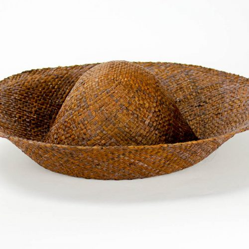 A chocolate brown flat weave raffia hatbody with finished edge