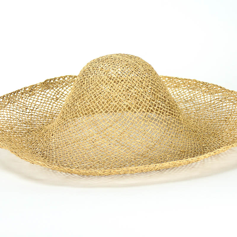 Loosely woven twisted natural raffia straw in 17/18 inch diameter.