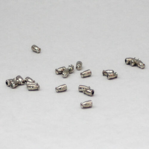 Silver. Small metal nibs with rubberized insert to cover sharp end of hatpin, assorted shapes.