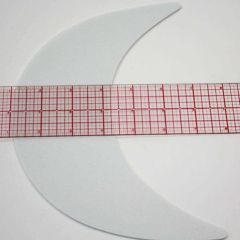 Washable 0.3 mm plastic board made of high-density polyethylene resin compressed foam (slightly less than 1/8 inch thick). 3-1/4 inch wide at center/fullest part of bill and 9 inches from point to point (laying flat).