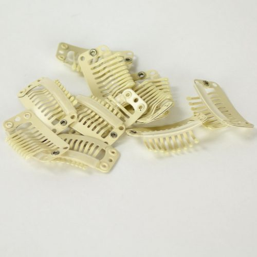 A small snap clip, Use in securing fascinators and smaller size hats to your hair.