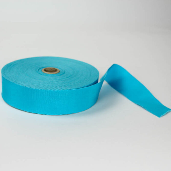 Turquoise Blue. Made in France. Blend of 44% rayon/ 56% cotton grosgrain belting with a saw-tooth edge.