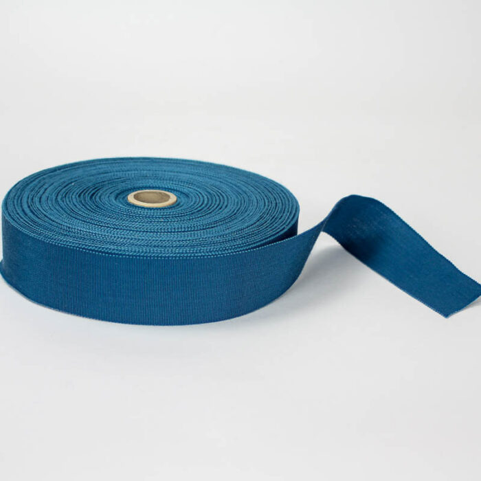 Teal Blue. Made in France. Blend of 44% rayon/ 56% cotton grosgrain belting with a saw-tooth edge.