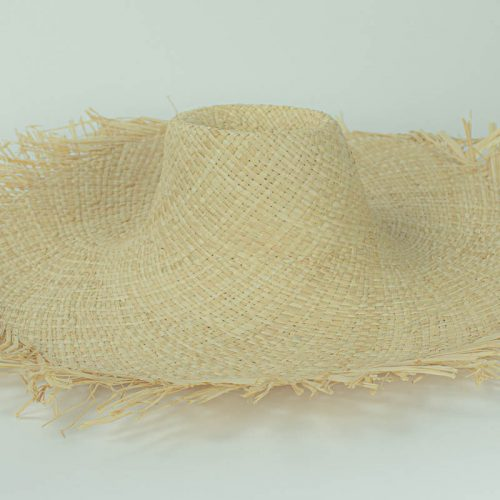 Natural, undyed flat weave raffia with raw edge and 5 inch brim. Remains soft and supple, will accept dye.