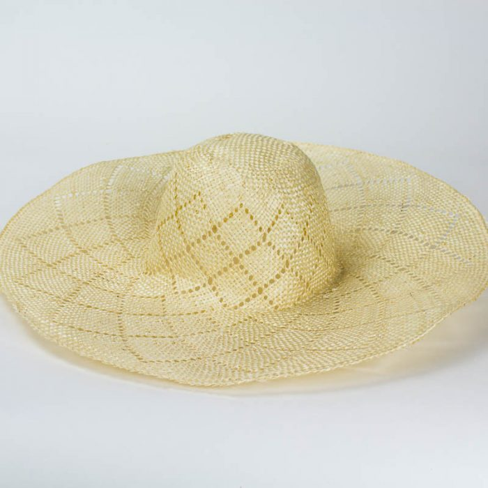 A natural woven sisal straw in a petal pattern.