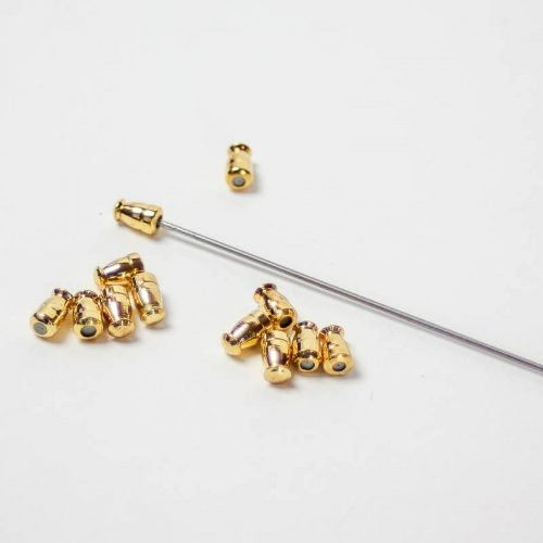 Gold Small metal nibs with rubberized insert to cover sharp end of hatpin, assorted shapes.