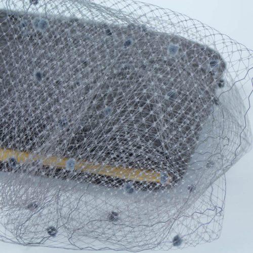 Evening Grey chenille dot Standard diamond pattern with 1/4 inch opening, 8-9 inch width, 100% nylon.