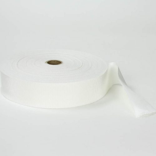 Eggshell or off-white. Made in France. Blend of 44% rayon/ 56% cotton grosgrain belting with a saw-tooth edge.