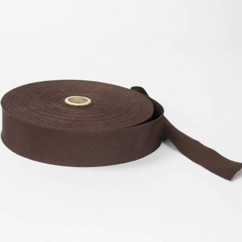 Dark Brown. Made in France. Blend of 44% rayon/ 56% cotton grosgrain belting with a saw-tooth edge.