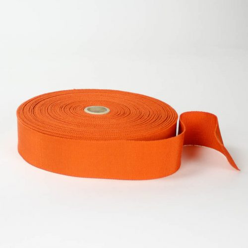 Burnt Orange. Made in France. Blend of 44% rayon/ 56% cotton grosgrain belting with a saw-tooth edge.