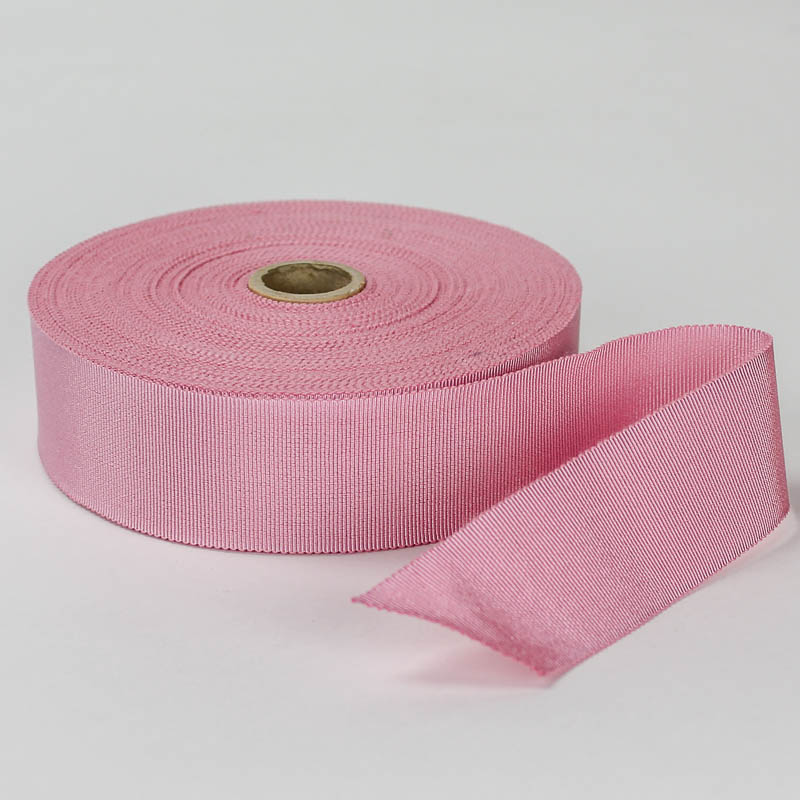 Pink. Made in France. Blend of 44% rayon/ 56% cotton grosgrain belting with a saw-tooth edge.