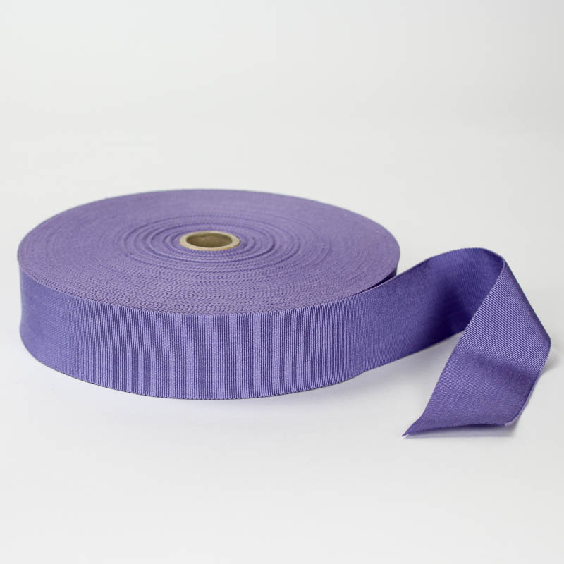 Lavender. Made in France. Blend of 44% rayon/ 56% cotton grosgrain belting with a saw-tooth edge.