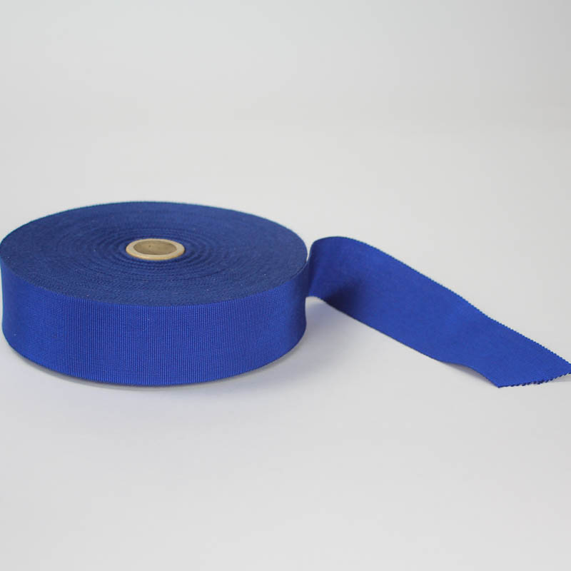 Royal Blue. Made in France. Blend of 44% rayon/ 56% cotton grosgrain belting with a saw-tooth edge.