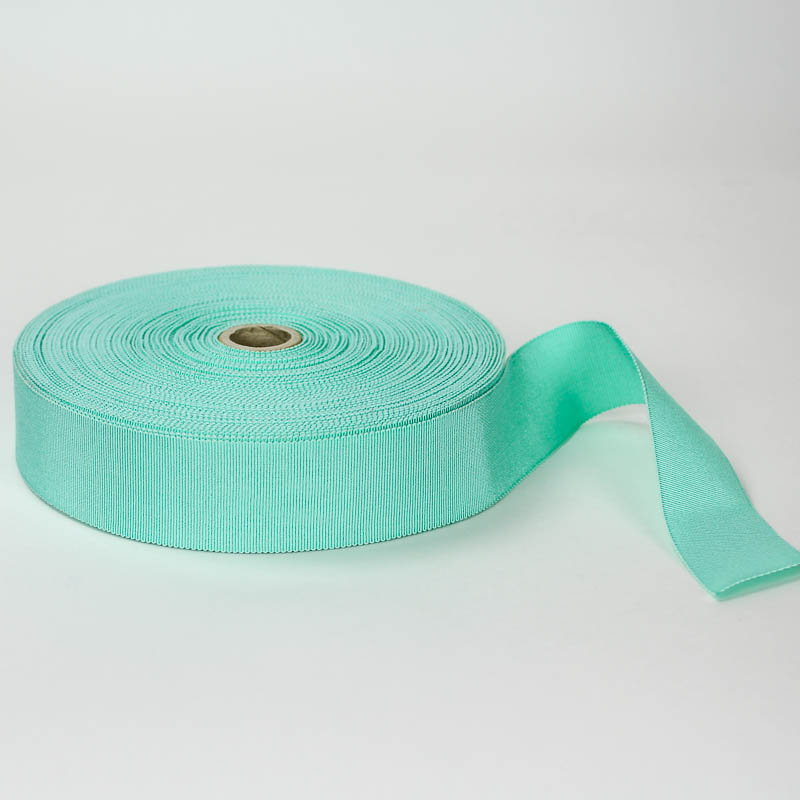 Aqua Green. Made in France. Blend of 44% rayon/ 56% cotton grosgrain belting with a saw-tooth edge.