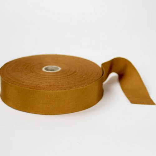 Pumpkin Tan. Made in France. Blend of 44% rayon/ 56% cotton grosgrain belting with a saw-tooth edge.