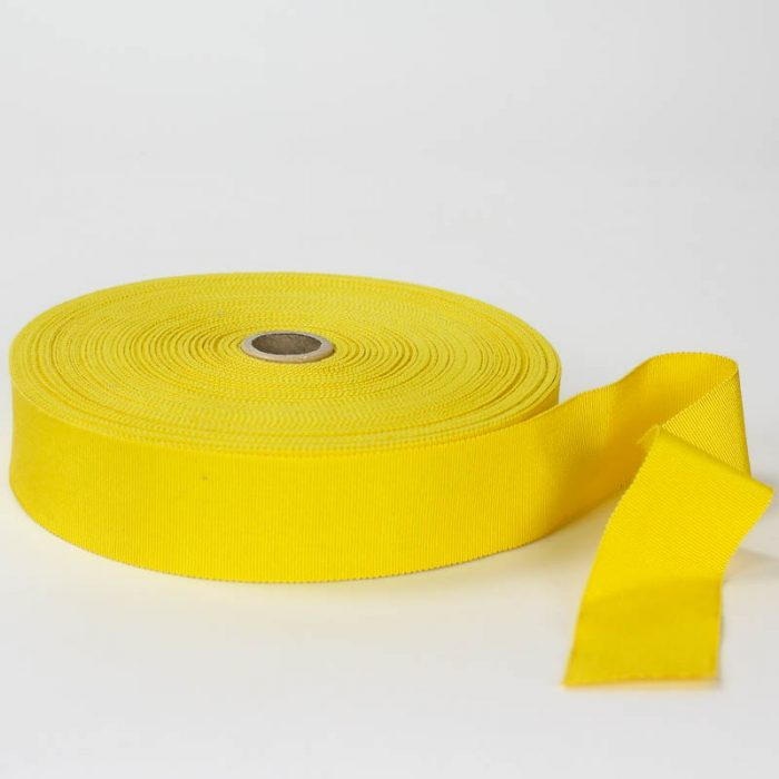 Bright Yellow. Made in France. Blend of 44% rayon/ 56% cotton grosgrain belting with a saw-tooth edge.
