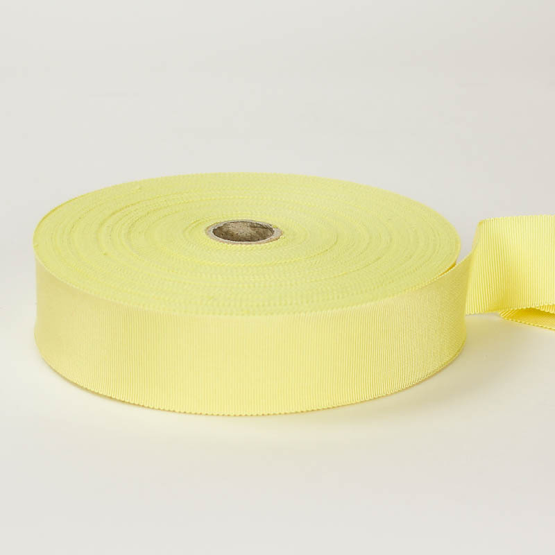 Pastel Yellow. Made in France. Blend of 44% rayon/ 56% cotton grosgrain belting with a saw-tooth edge.