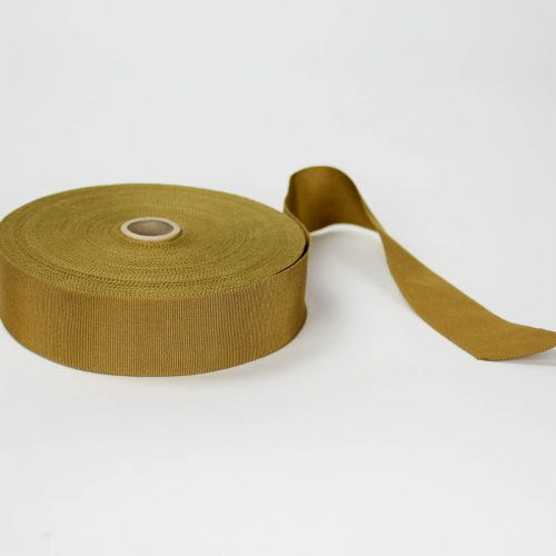 Golden Tan. Made in France. Blend of 44% rayon/ 56% cotton grosgrain belting with a saw-tooth edge.