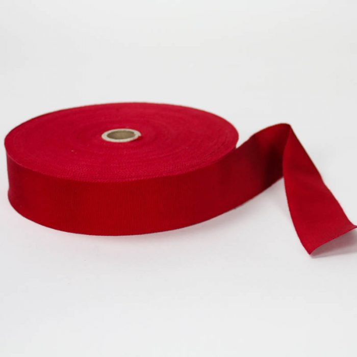 Berry Red. Made in France. Blend of 44% rayon/ 56% cotton grosgrain belting with a saw-tooth edge.