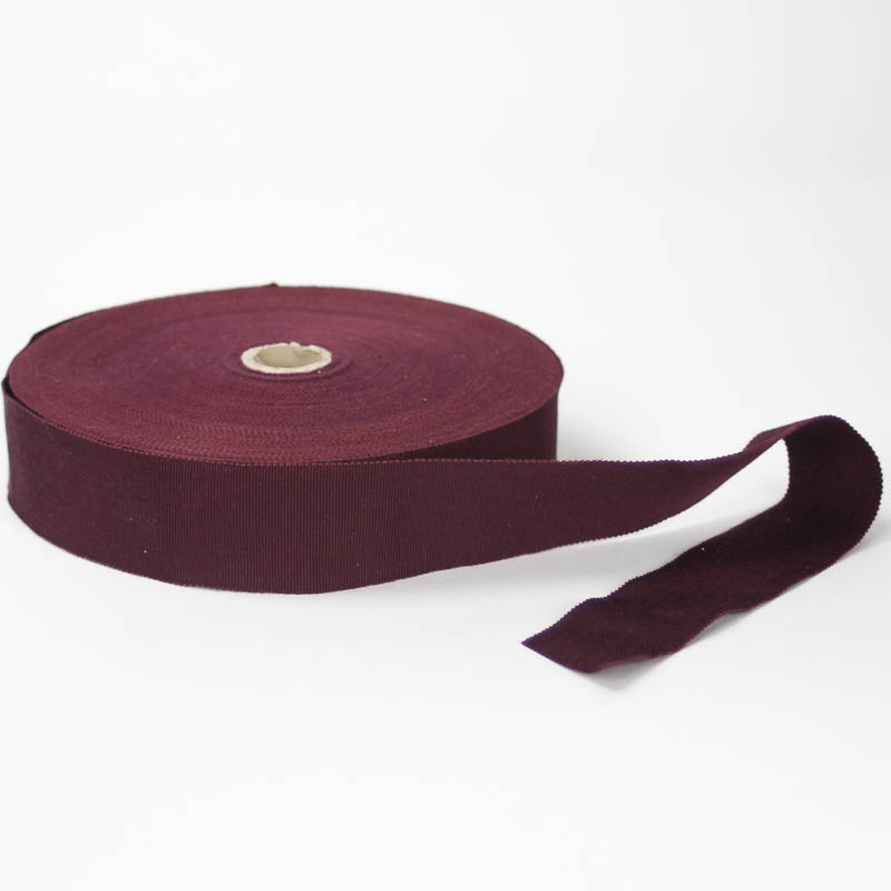 Bordeaux. Made in France. Blend of 44% rayon/ 56% cotton grosgrain belting with a saw-tooth edge.
