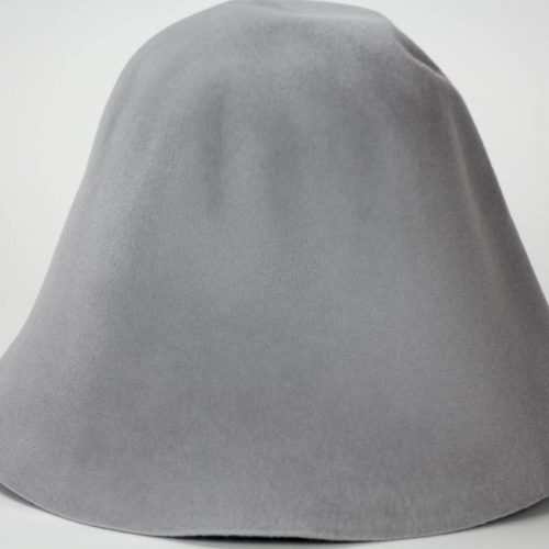 Light Grey hood, or cone shape, with velour finish on outside only. Plush velour velvet look on outer side.