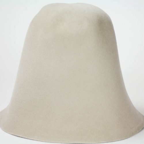 Light Beige hood , or cone shape, with velour finish on outside only. Plush velour velvet look on outer side.