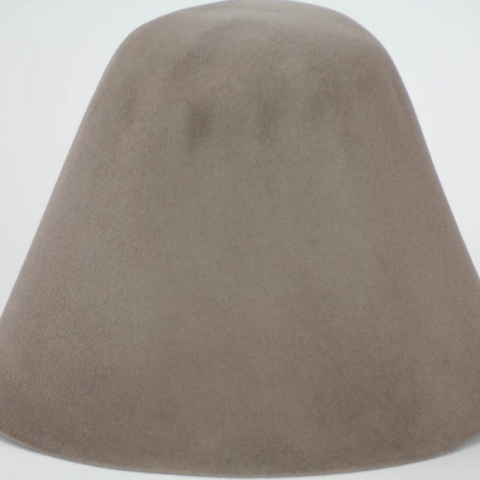 Putty brown, almost black, hood, or cone shape, with velour finish on outside only.