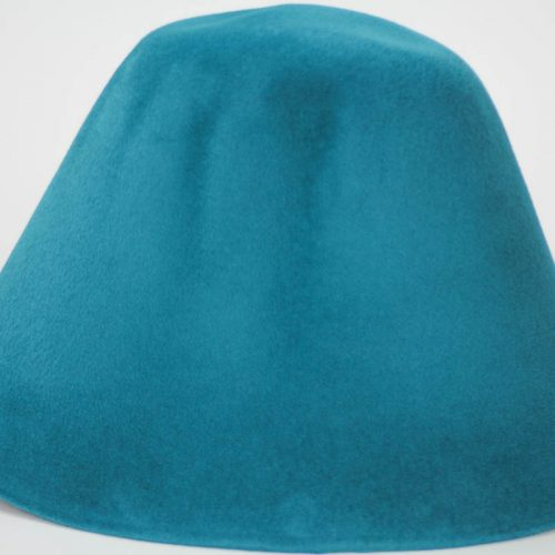 Peacock teal hood, or cone shape, with velour finish on outside only.
