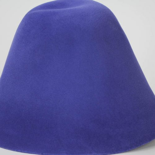 A bright blue hood, or cone shape, with velour finish on outside only.