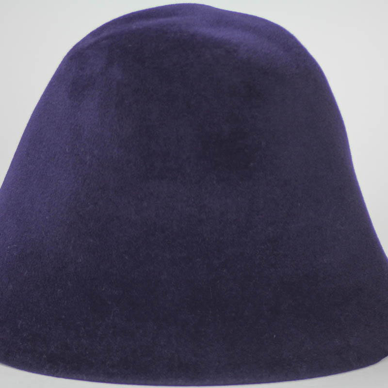 Navy blue hood, or cone shape, with velour finish on outside only