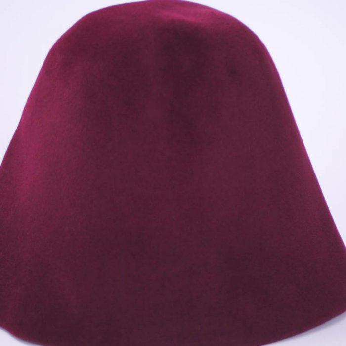 Burgundy wine hood, or cone shape, with velour finish on outside only.
