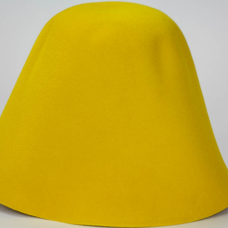 Bright yellow hood, or cone shape, with velour finish on outside only.