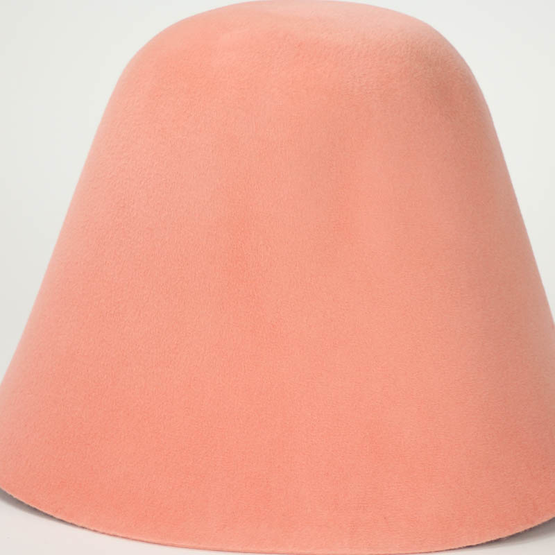 Apricot hood, or cone shape, with velour finish on outside only.