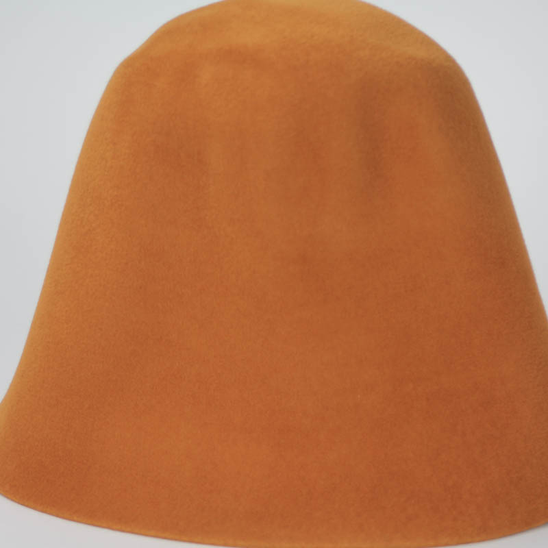 Pumpkin shell shade hood, or cone shape, with velour finish on outside only.
