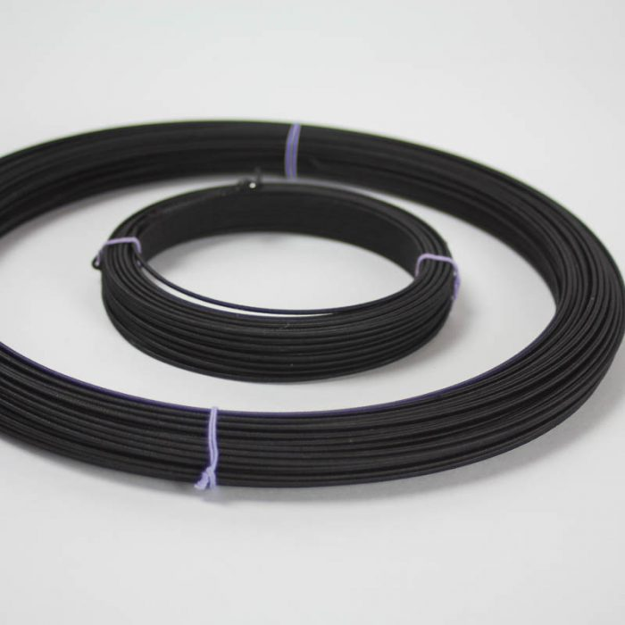 Rayon covered wire in black, #18 (1.02 mm). Used mostly in reinforcing hat brims and creating shapes and frames.