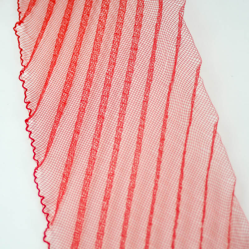 A pleated horsehair with 1/2 inch pleating running through, on diagonal to width.