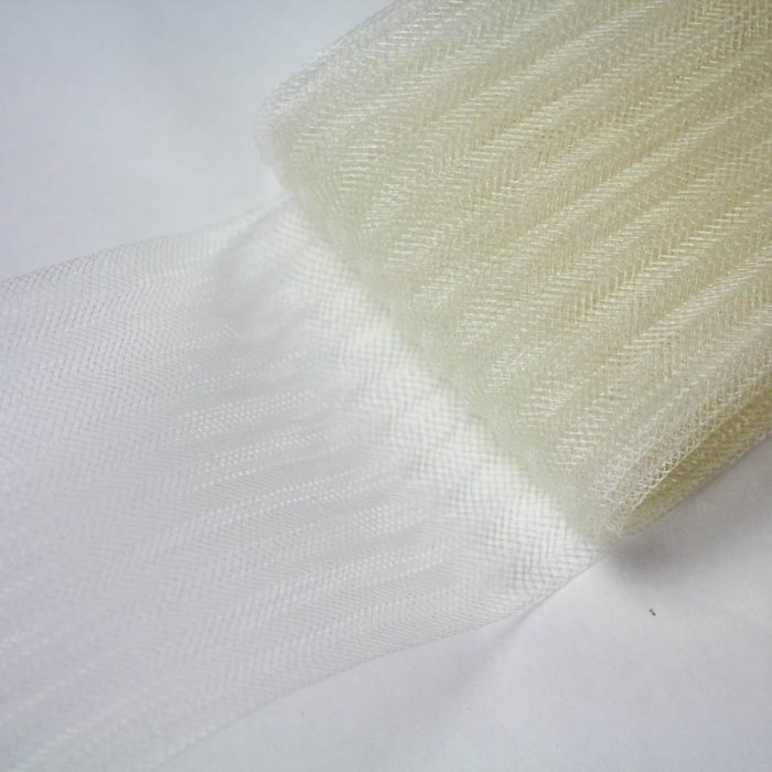 Ivory pleated horsehair with 1/4 inch pleating running through, parallel to length.