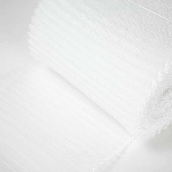 White polyester, very flexible, 1/4 inch pleats.