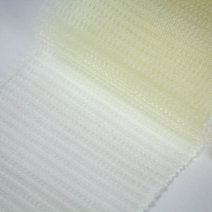 Ivory polyester, very flexible, 1/4 inch pleats.