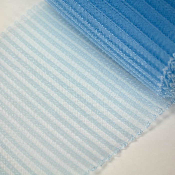 Pastel Blue polyester, very flexible, 1/4 inch pleats.