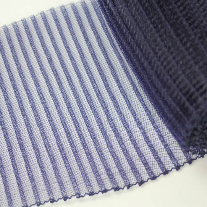 Navy blue polyester, very flexible, 1/4 inch pleats.