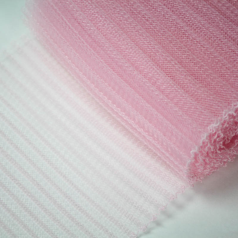 Pink polyester, very flexible, 1/4 inch pleats.