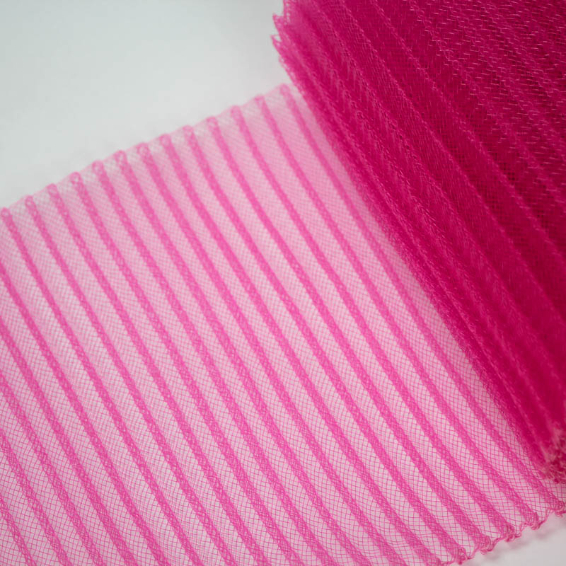 Hot Pink polyester, very flexible, 1/4 inch pleats.