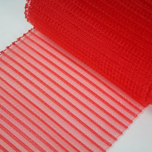 Red polyester, very flexible, 1/4 inch pleats.