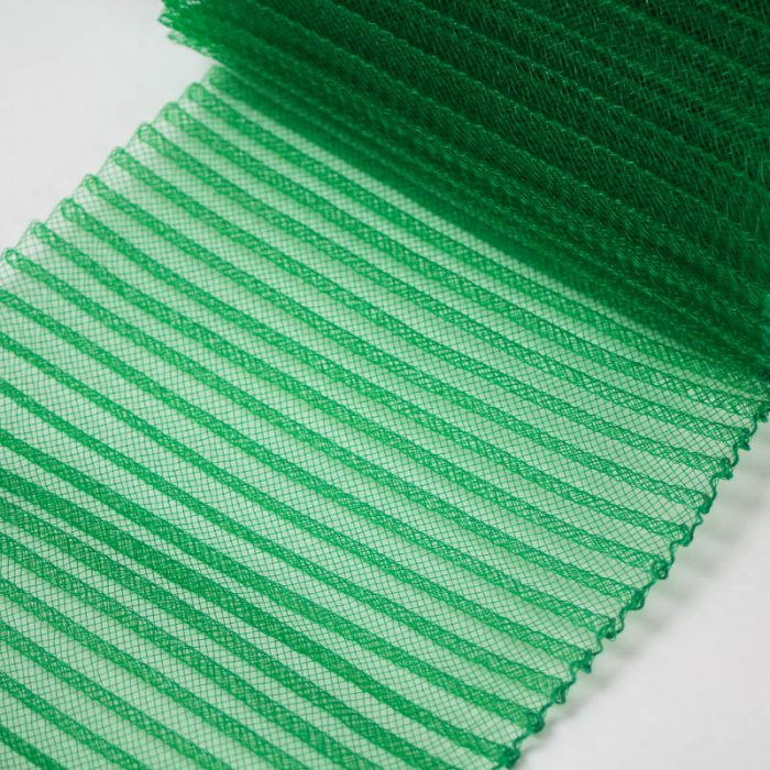 Emerald Green polyester, very flexible, 1/4 inch pleats.