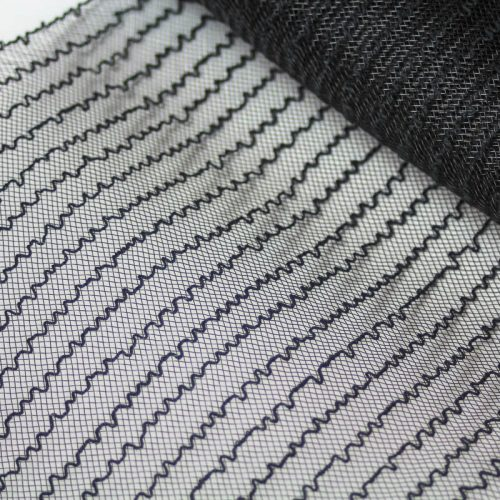Black horsehair with a cotton thread runs every half inch for gathering purposes.
