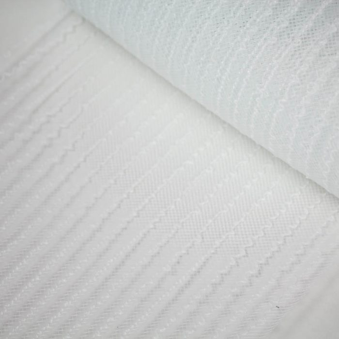 White horsehair, A cotton thread runs every half inch for gathering purposes.