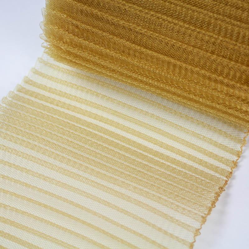 A non-metallic dark gold polyester, very flexible, 1/4 inch pleats.